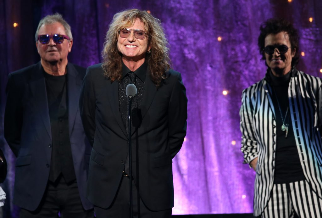 """""""NEW YORK, NEW YORK - APRIL 08:  (L-R) Ian Gillian, David Coverdale, and Glenn Hughes of Deep Purple speak onstage at the 31st Annual Rock And Roll Hall Of Fame Induction Ceremony at Barclays Center of Brooklyn on April 8, 2016 in New York City.  (Photo by Kevin Kane/WireImage for Rock and Roll Hall of Fame)"""""""